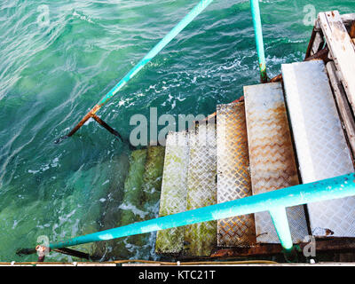steps to water on Coral beach of Red Sea in Aqaba - Stock Photo