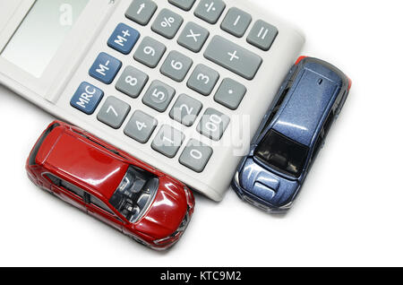 Blue and red car with calculator - Stock Photo