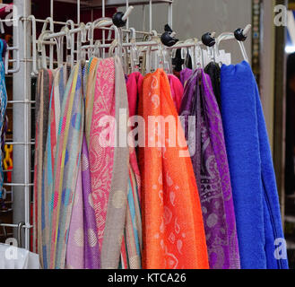 Colorful neckwears for sale at Asian street market. Street market in Chinatown, Singapore. - Stock Photo