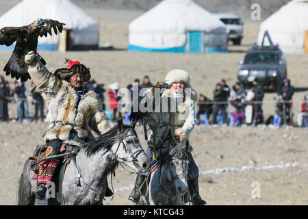 Aisholpan and her father from The Eagle Huntress at the Golden Eagle Festival in Mongolia - Stock Photo