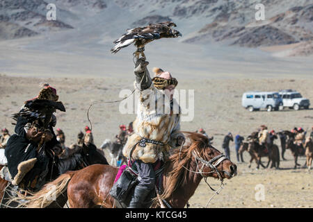Kazakh eagle hunter at the Golden Eagle Festival in Mongolia - Stock Photo