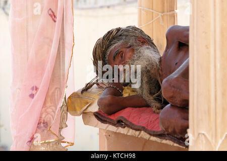 An Indian Holy man (Sadhu, Saddhu) at the Ghats, Pushkar, Rajasthan,India - Stock Photo