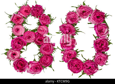 Arabic numeral 80, eighty, from red flowers of rose, isolated on white background - Stock Photo