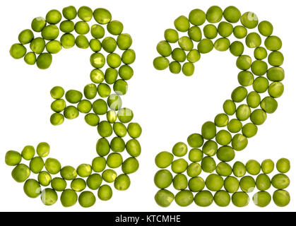 Arabic numeral 32, thirty two, from green peas, isolated on white background - Stock Photo