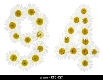 Arabic numeral 94, ninety four, from white flowers of chamomile, isolated on white background - Stock Photo