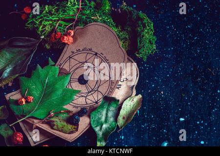 Pentagram drawing on a parchment with potion ingredients in a magical scene. Modern witchcraft concept with copy - Stock Photo