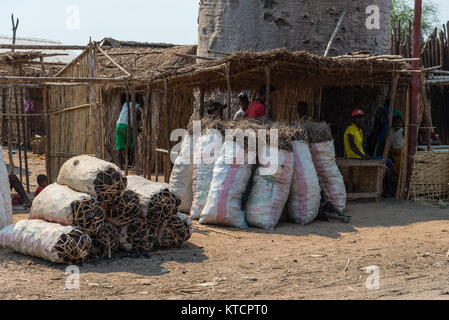 Sacks full of charcoal for sale. It's the main source of cooking fuel in rural Madagascar, Africa. - Stock Photo