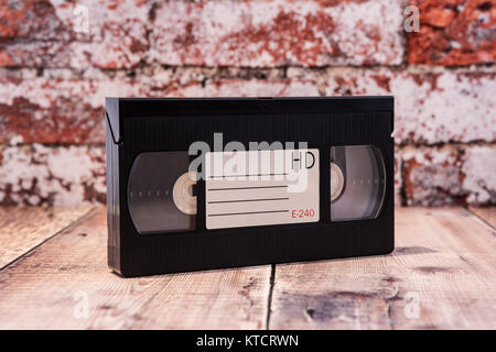 Old VHS Video cassette tape on a rustic background. - Stock Photo