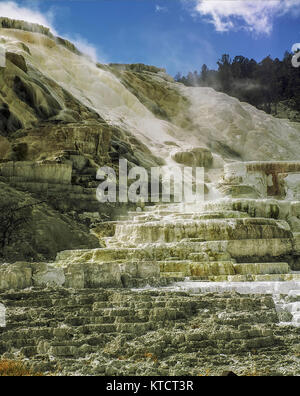 Mammoth hot springs geothermal area of the Yellowstone National Park, Wyoming, United States of America - Stock Photo