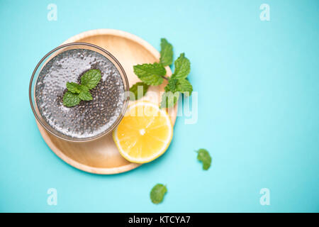 Selective focus of chia seeds drink with water in transparent glass with lemon balm. - Stock Photo