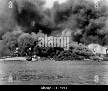 Pearl Harbor Attack, 7 December 1941 -  View of Battleship Row during or immediately after the Japanese raid. USS - Stock Photo