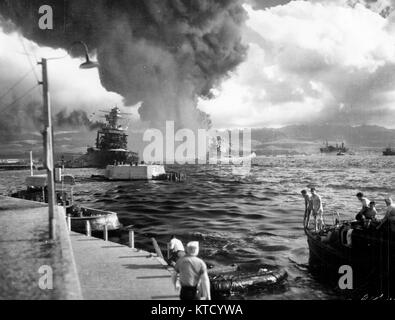 Pearl Harbor Attack, 7 December 1941 - View looking down Battleship Row from Ford Island Naval Air Station, shortly - Stock Photo