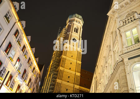MUNICH, GERMANY - DECEMBER 11, 2017 : A view of the Cathedral of Our Lady at night in center of Munich, Germany. - Stock Photo