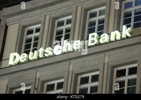 MUNICH, GERMANY - DECEMBER 11, 2017 : Close up of Deutsche bank logo on a building at night in Munich, Germany. - Stock Photo