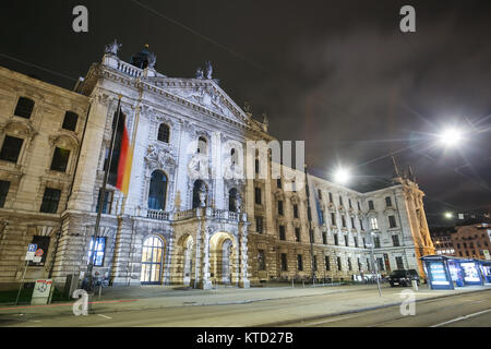 MUNICH, GERMANY - DECEMBER 11, 2017 : A view of the District Court exterior at night in Munich, Germany. - Stock Photo