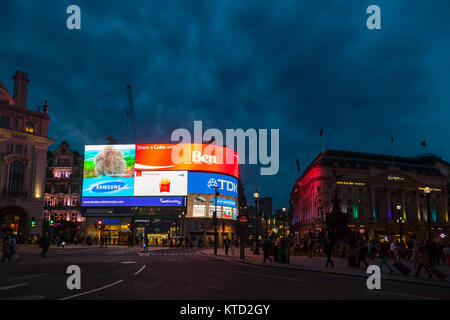 LONDON, UK - JUNE 17, 2013: illuminated large LED video advertising display at Piccadilly Circus road junction, - Stock Photo