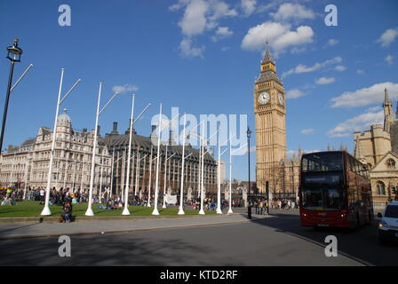 London, United Kingdom - April 11, 2015: Big Ben, Palace of Westminster, London Eye and red bus - Stock Photo