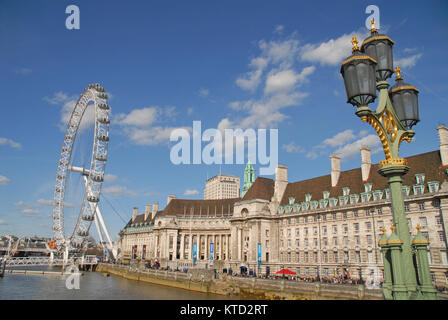 London, United Kingdom - April 11, 2015: County Hall, River Thames and London Eye photographed from Westminster - Stock Photo