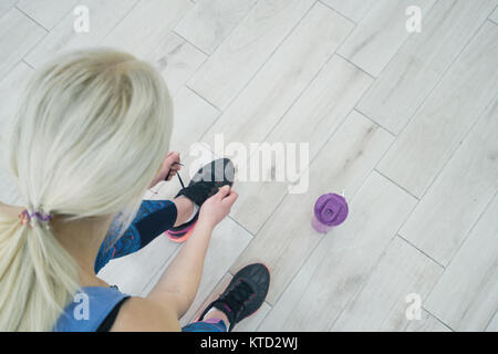 attractive fit women in gym preparing for workout - Stock Photo