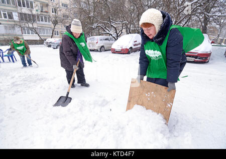 After blizzard. Municipal workers removing snow and ice from streets of Kyiv. January 12, 2016. Kyiv, Ukraine. - Stock Photo