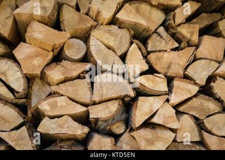 Stacked, split oakwood ready for the winter - Stock Photo