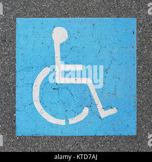 Handicapped parking sign paint on asphalt - Stock Photo