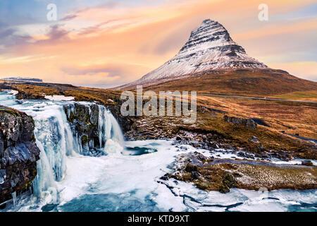 Kirkjufell mount and waterfall. Kirkjufell (Church mountain) is a 463m high mountain on the north coast of Saefellsnes - Stock Photo