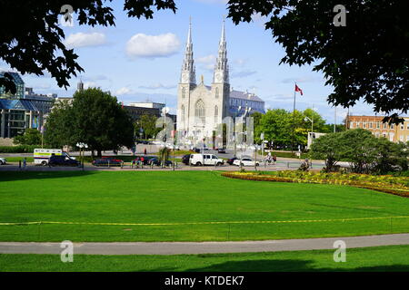 A view of the Notre-Dame Cathedral Basilica from Major's Hill Park in downtown Ottawa, Ontario, Canada - Stock Photo