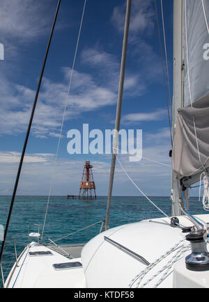Florida Keys - Charter catamaran sails to offshore lighthouse - Stock Photo