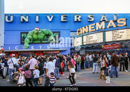 LOS ANGELES, CALIFORNIA, USA, DECEMBER 25, 2006 - Some people line up at the cinema box office inside Universal - Stock Photo