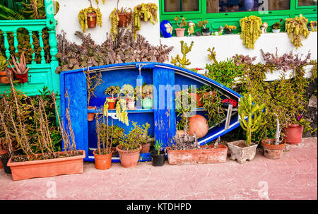 Traditional fishing boat with floral decoration in Punta Mujeres village,Lanzarote,Canary,Spain. - Stock Photo