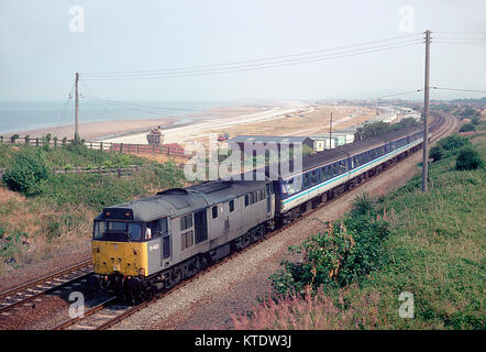 A class 31 diesel locomotive number 31462 working a Regional Railways service along the north Wales coat line near - Stock Photo