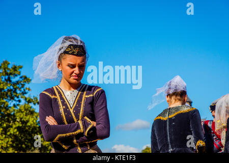 TBILISI, GEORGIA - OCTOBER 15: Portrait of a woman dressed in a traditional Georgian dress at the festival. October - Stock Photo