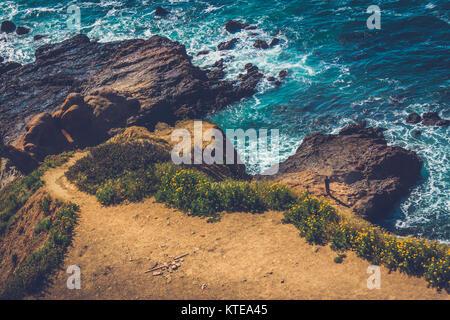 Hiking trail cascading down the treacherous cliffs of Flat Rock Point, Palos Verdes Estates, California - Stock Photo