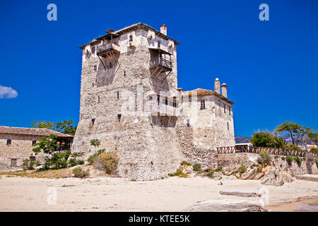 Historic fort in port Ouranoupolis , entry site to monasteries of Mount Athos, Chalkidiki, Greece. - Stock Photo