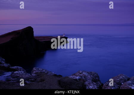 The Neist Point lighthouse at Isle of Skye in Scotland - Stock Photo