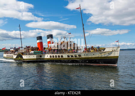 The Waverley Paddle Steamer approaching the town of Largs on the Firth of Clyde, North Ayrshire, Scotland UK - Stock Photo