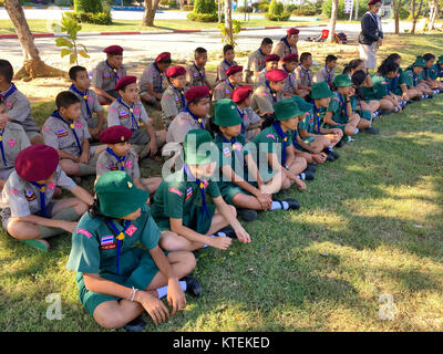 Girl scouts in Thailand Schoolpracticing on ground practicing with their teacher in Thai school. Hua Hin, Thailand - Stock Photo