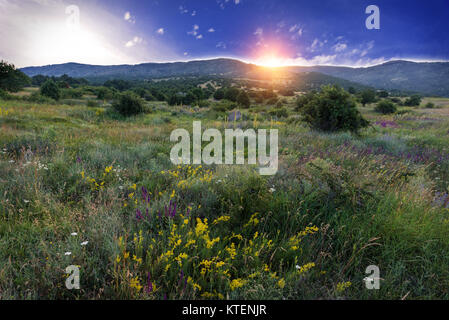 Sunset in the Agarmysh mountains colorful field landscape - Stock Photo