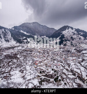 Aerial drone image of the amazing Metsovo town in Northern Greece covered in snow. - Stock Photo