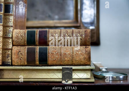 Antique Books. Vintage Antiquarian Books piled on wooden surface. Closeup. - Stock Photo