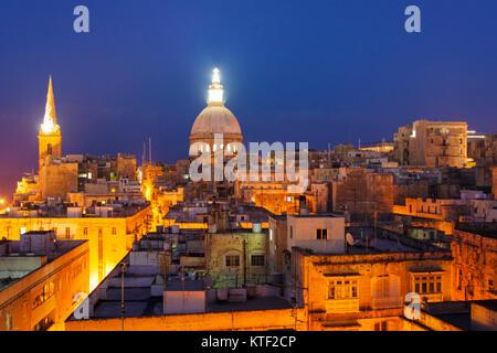 Overview at dusk of illuminated historic city of Valletta, Malta - Stock Photo