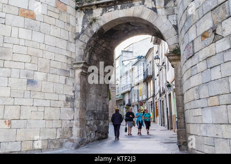 San Pedro Gate (18yh century) at the Roman walls, used by the pilgrims of the Camino de Santiago to enter the city. - Stock Photo