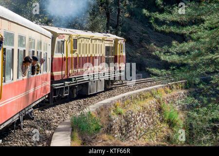 Shimla Kalka narrow gauge toy train on scenic journey to Kalka, Haryana, India - Stock Photo