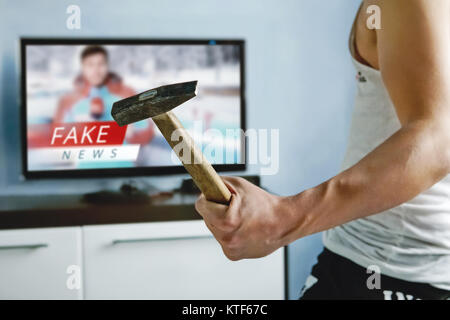 A psychopath wants to crash the TV with a hammer. The viewers got tired of false news. Truth misrepresented in the - Stock Photo