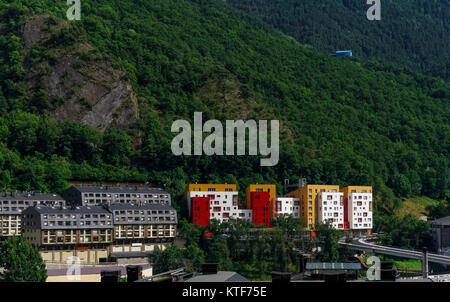Andorra la Vella, Andorra day view of buildings by the mountain. Traditional and modern houses on the Andorran capital. - Stock Photo