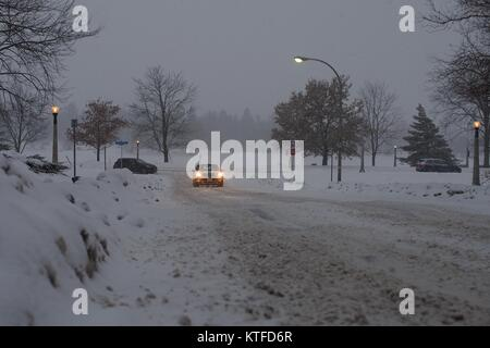 A car drives through a blizzard up a snowy Lakeside Avenue from Queen Elizabeth Dr., Dow's Lake, Ottawa, Ontario, - Stock Photo