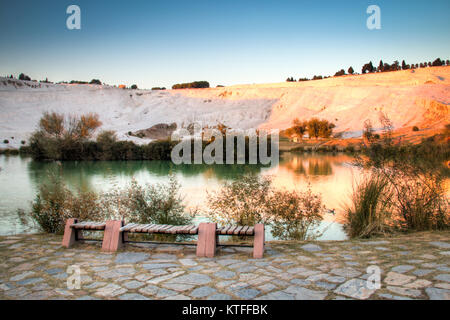 Sunset over the beautiful landscape of the travertine pools and terraces in Pamukkale in Turkey - Stock Photo