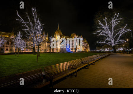 The Hungarian parliament with Christmas lights - Stock Photo