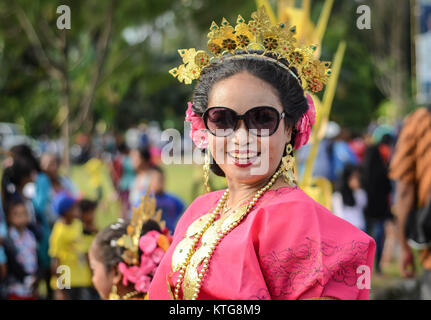 Modern Sulawesi woman dress in traditional Bugis clothes - Stock Photo